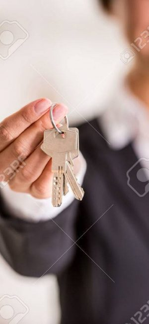 39393958-realtor-is-giving-the-keys-to-an-apartment-to-clients-focus-on-the-keys-